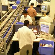 Express Scripts workers fill mail order drugs.