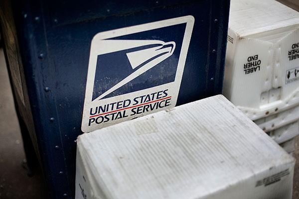 U.S. Postal Service narrowed its losses in second quarter, but mail volume continues to decline.