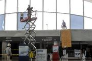 Workers on Saturday cleaned up Lambert after Friday's storms damaged the airport.