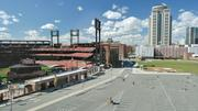 The Cardinals had hoped to build Ballpark Village in time for the 2009 Major League Baseball All-Star Game but the recession puts plans on hold. Instead, the Cardinals turned the area into a softball field and parking lot.