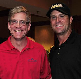 Ranken Jordan's chief medical officer, Dr. Nick Holekamp, left, with former Cardinals catcher Mike Matheny. Matheny's Catch 22 Foundation gave $100,000 to build a wheelchair-accessible ball field on the hospital's campus.