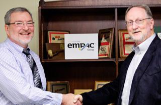 Bob Koch (left) and Eric Giebler shake to formalize their affiliation as Empac Group Inc.