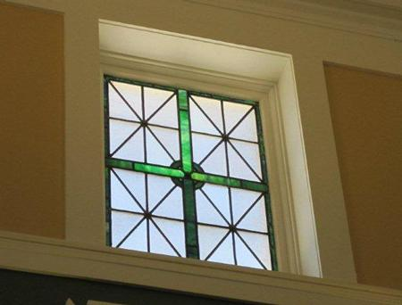 A stained glass window, which was formerly obscured by a drop ceiling, at the St. Louis Public Library's newly renovated Carondelet Branch.