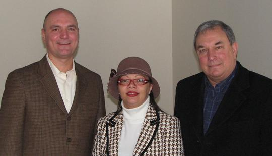 From left, Lenny Knese, president of National Sales Co.; Alderwoman April Ford-Griffin; and Bill Laskowsky with McEagle.