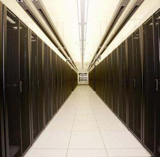 A pod of cabinets in Xiolink's renovated data center hold servers.