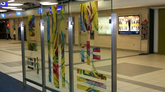 Two new art glass screens, each consisting of three panels 5.5 feet high and 3 feet wide, were installed in Concourse A at Lambert-St. Louis International Airport. This screen was designed by artist Edna Patterson-Petty.