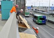 Workers from C. Rallo Contracting work on fixing Lambert airport Wednesday.
