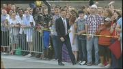 Host Ryan Seacrest passes a sea of fans in St. Louis on Tuesday.