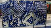 Two new art glass screens, each consisting of three panels 5.5 feet high and 3 feet wide, were installed in Concourse A at Lambert-St. Louis International Airport. This screen was designed by artist Lauren Adams.