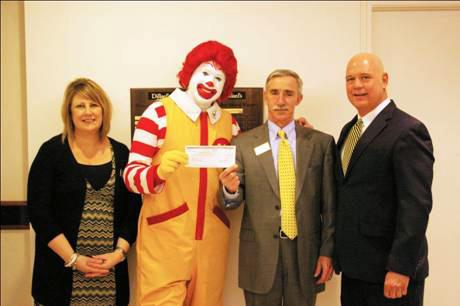 Janice White, assistant store manager of Dillard's at Chesterfield Mall; Ronald McDonald; Clement Sheridan, store manager of Dillard's at Chesterfield Mall; and Frank Cognata, vice president of development at Ronald McDonald House Charities of Metro St. Louis.