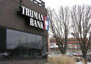 Truman, with $370 million in total assets, reported a loss of $2.4 million through June 30.