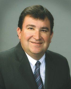 Tom Flores St. Louis regional president, Midland States