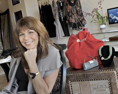 Lisa McKinney, in her new Athena Boutique in Frontenac Grove Plaza.
