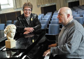 Beth Stroble (left), Webster president, and Jeffrey Carter, music department chairman, at a Steinway with Beethoven.