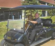 Biondi often drives around SLU's campus in his golf cart, 