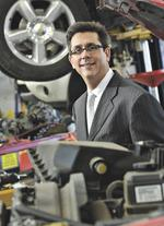 Sales of luxury, hybrid cars speed up