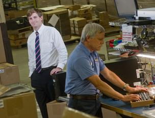 Beau Brauer, left, and Al Luehrmann on the CPU assembly line at Hunter Engineering, where annual sales from exports tops $100 million.