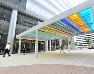 A glass art canopy, designed by British artist Liam Gillick, connects the Centene Plaza office tower to the development's parking garage.
