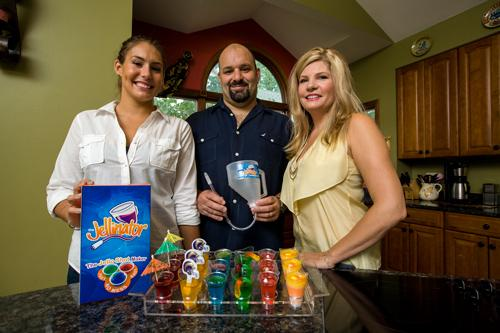 When teacher Trish Piazza (right) got laid off, she and husband Matt Piazza (middle), an electrical engineer, and their daughter Francesca Piazza (left) invented a Jell-O shot maker, secured a patent and named it the Jellinator.