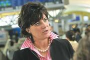 Rhonda Hamm-Niebruegge - 1,500 pieces of plywood cover broken windows at the airport