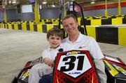 A former race team manager, owner, driver and commentator, Mike Johnson (with son Conner, age 8) continues his motorsports career with Pole Position Raceway-St. Louis.