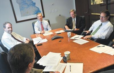 Leadbeater meets with colleagues (from left) Jeff Potthast, Darryl Collins, Jack Schreiber and Steve Reynolds.