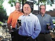 Scott Kemper, Brett Bennett and Chris Marshall own Llywelyn's Pub.