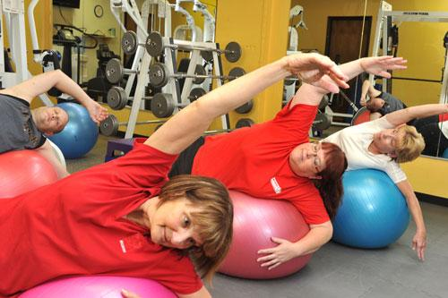 From left: McCarthy employees Chris Thiele, Barb Porter, Cheryl Slazinik and Sherry Clark take part in an exercise class at an onsite fitness center.