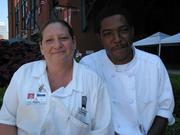 Michelle Kennon andJohn Robinson Jr., concession catering cooks, Delaware North Sportservice at Busch Stadium