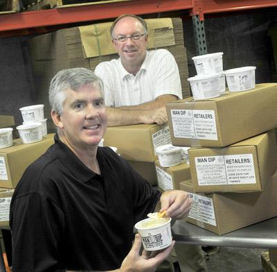 Dr. Ted Mimlitz (left), an ob-gyn, and Andy Wolf (right), owner of Peistrup Paper Products, concocted ManDip.