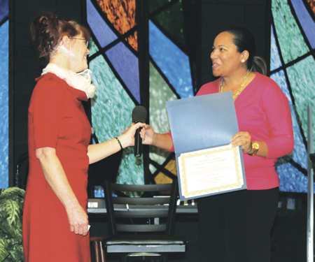 Graduate Pat Baccus (right) accepts her certificate for the completion of the personal and professional development course at Connections to Success.