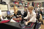 """Laura Maurice, left, and Diana Ford sift through merchandise during an episode of """"Resale Royalty."""""""
