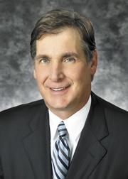 Jim Regna -Triad Bank is spending an additional $150,000 a year on compliance