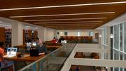 In the space, the library reading area is connected by open air between the two floors, and framed in by large glass windows that offer a view of the Civil Courts Building.