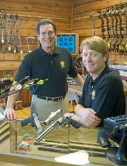 Joe Scott Jr. (left) and Joe Scott III at their gun and archery store in St. Peters. They own at least three other local businesses.