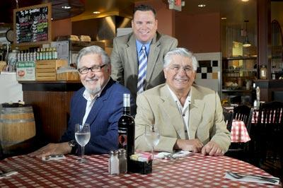 Kim Tucci (left) and Joe Fresta (right), owners of The Pasta House Co., have invested in RealDealstl.com, an online deal-of-the-day site, partnering with brothers Tim (middle) and Joe Brunette.