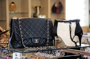 On the rack: A Chanel bag (retail $4,000; resale $2,600), boots (retail $1,100; resale $399)