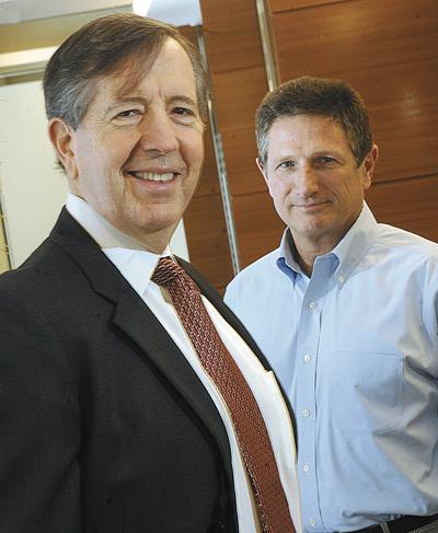 Joe Conran (left) will remain on the firm's executive committee when Greg Smith takes the top management job.