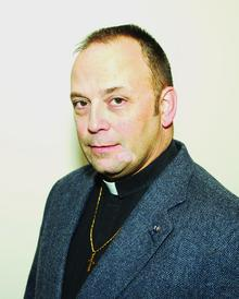 Rev. Dennis Wenholz