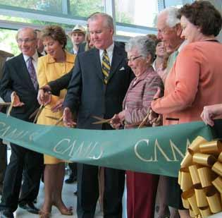 Tampa Mayor Bob Buckhorn and others at a ribbon cutting celebrating the March 30 official opening of CAMLS in downtown Tampa.