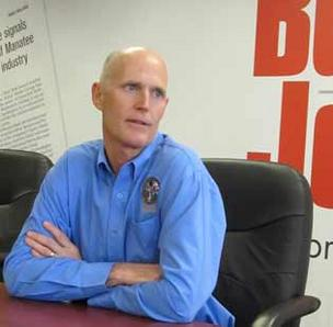 Gov. Rick Scott has asked school districts to review emergency procedures and enhance on-campus security measures in the wake of the massacre at a Connecticut school last week.
