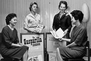 Members of the Cookbook Committee in 1960, including Chair Deedee Gray, second from right.