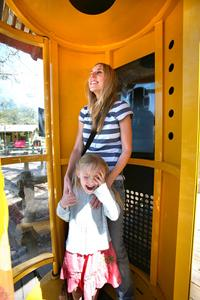 Christine McLachlan and daughter, Amelia, tried out the hurricane simulator called Tasmanian Tornado at Tampa's Lowry Park Zoo.
