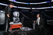 Louis Mendelsohn from Market Technologies watches Russell Samson working on the ice sculpture during the party.