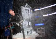 Russell Samson works on the ice sculpture.