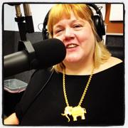 "Brenda Martin, co-host of the ""State of Happiness"" radio show, wearing a souvenir from the 1980 RNC in Detroit."