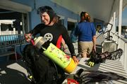 Linda Griffin, dive lead volunteer, gets her dive equipment ready to clean the shark tank.