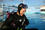 Linda Griffin, dive lead volunteer, finishes her one hour and 15 minute dive in the outside dolphin tank.