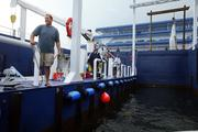 Ryan Nelson, general manager, greets a boat as it pulls in.