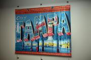 Club-level artwork features satin canvas photographs of Tampa Bay.